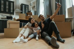 A family taking a picture while moving house