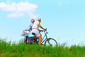 A senior couple rides bikes in one of US states that offer the best quality of life for the elderly