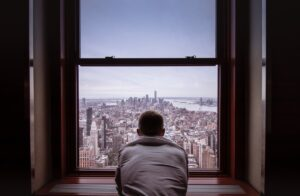 An expat looking through a window after moving to NYC