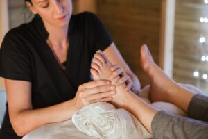 A woman applying pressure on a foot